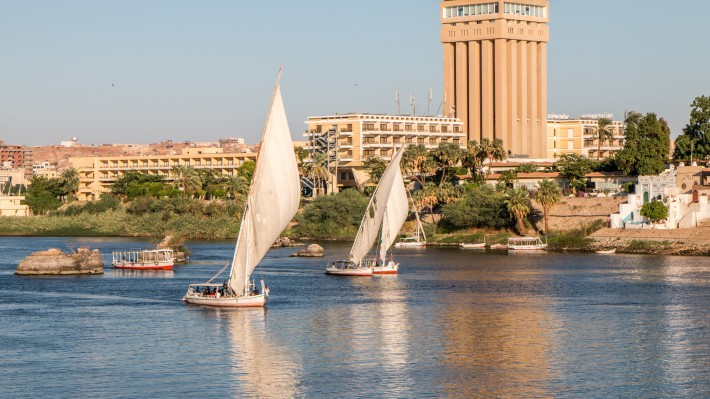 Fellucas sailing the Nile in Aswan, Egypt